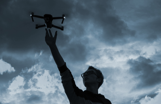 Man holding a drone with his hand