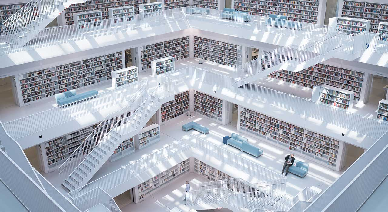 Huge library building from insight, the stairs and design is all white represents The focus on innovation and digitalization