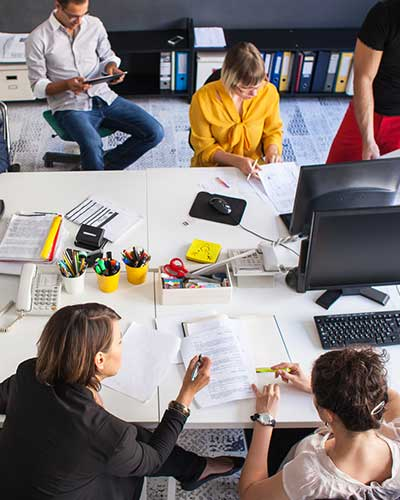 People Working Around a Desk represents our multidisciplinary teams