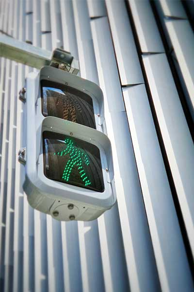 Green pedestrian traffic light represents the effectiveness, accuracy and risk reduction of test procedures